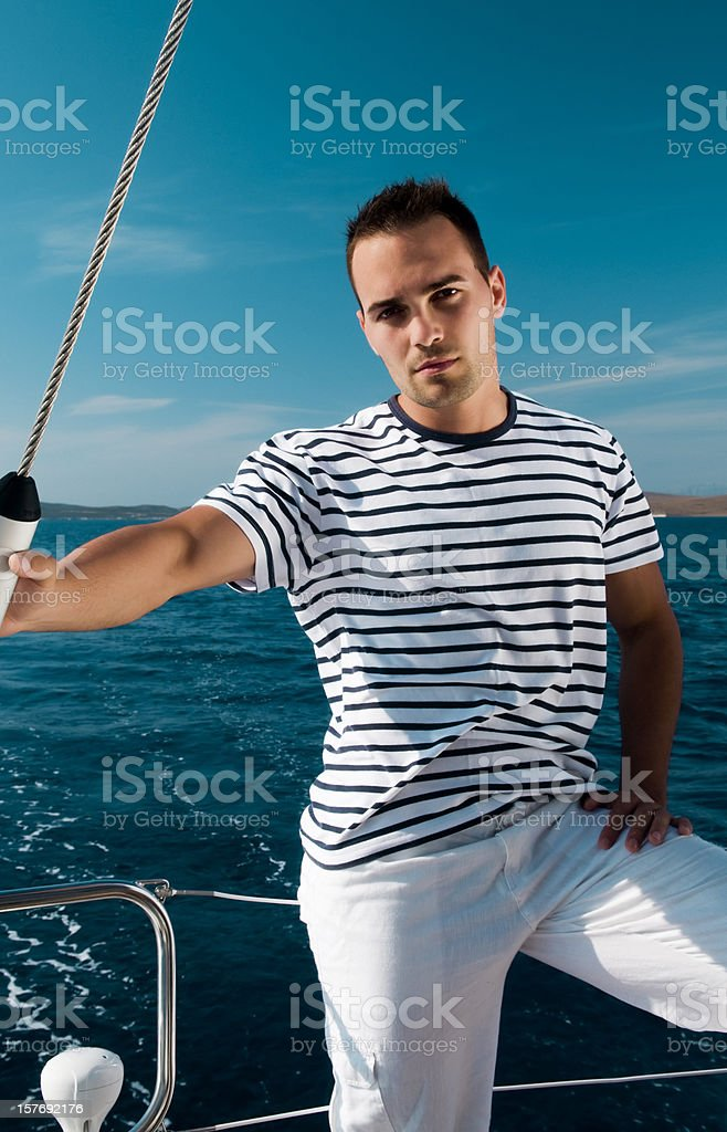 Attractive male on the yatch royalty-free stock photo