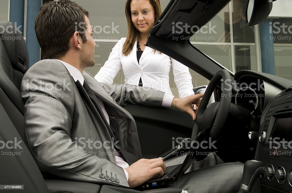 Attractive male with convertible stock photo