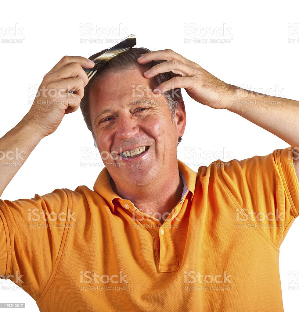 attractive man combing his hair royalty-free stock photo