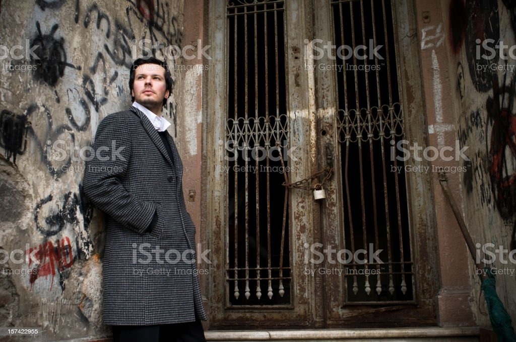 Attractive man in backstreets stock photo