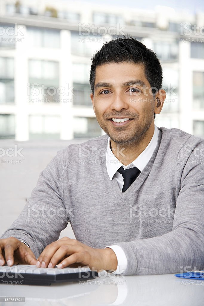 Attractive Man in Front of Office Window royalty-free stock photo