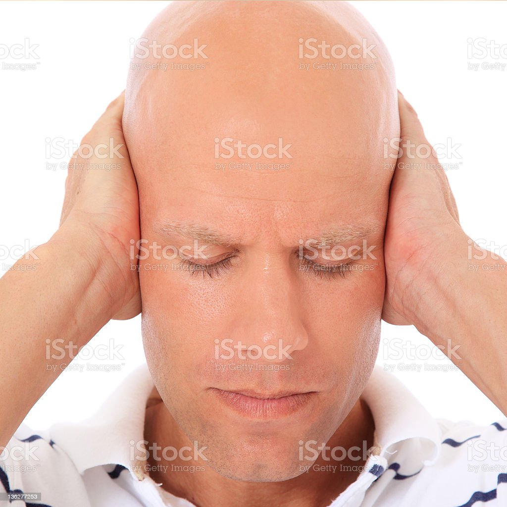 Attractive man keeps his ears shut royalty-free stock photo