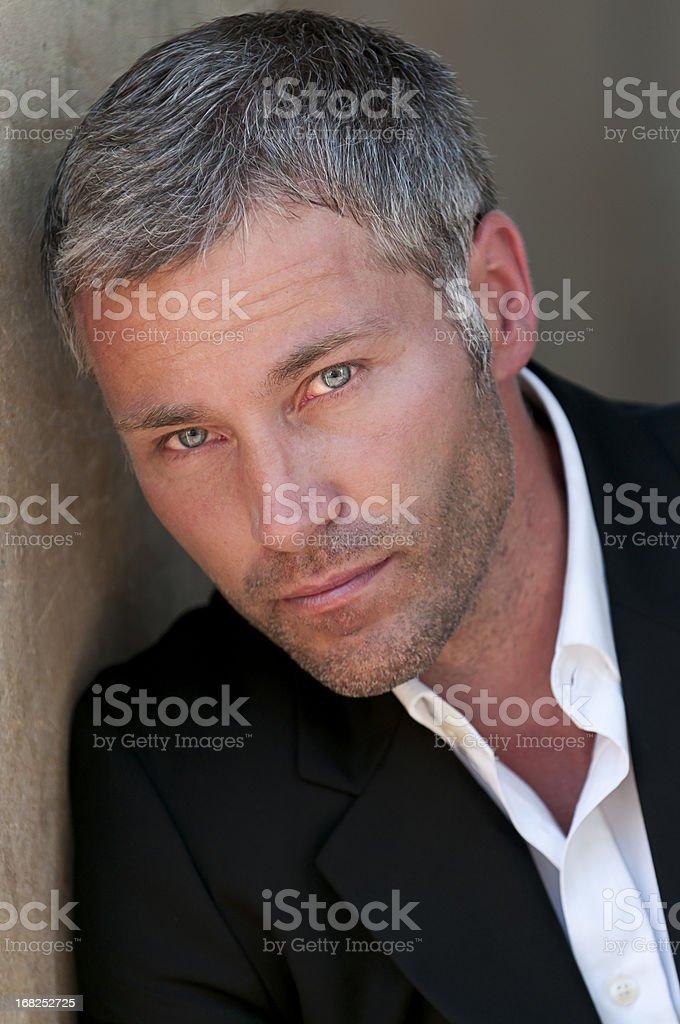 attractive man looking at camera stock photo