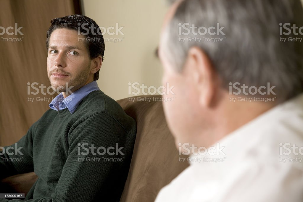 Attractive Man Looking At His Role Model For Guidance royalty-free stock photo