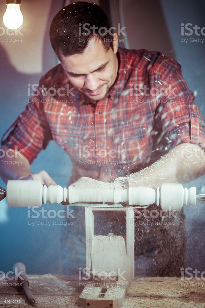 Attractive Man Making Woodturning Carved Detail stock photo