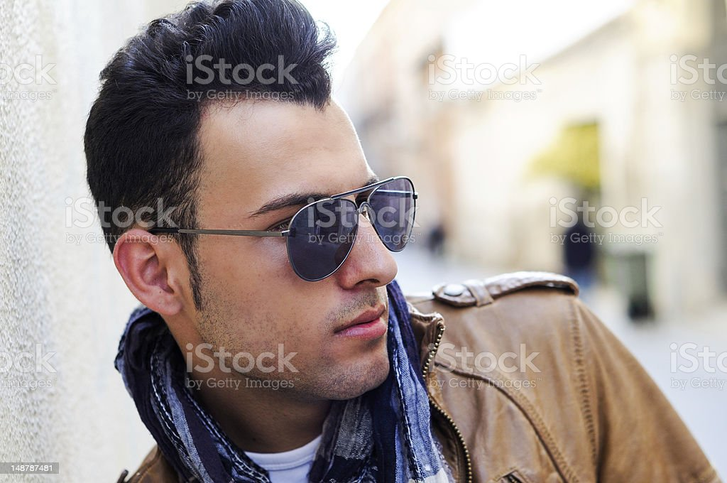 Attractive man, model of fashion, wearing tinted sunglasses stock photo