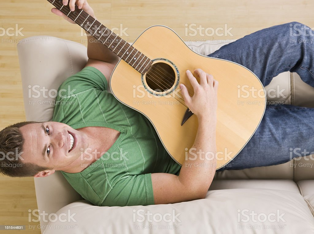 Attractive Man Playing Guitar royalty-free stock photo