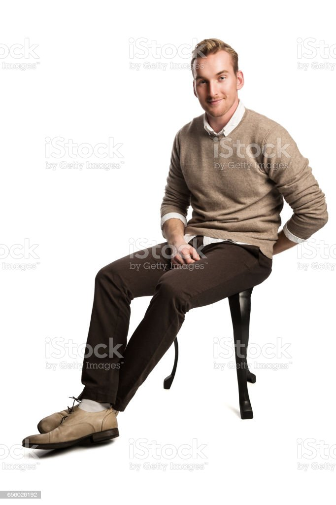 Attractive man smiling wearing sweater stock photo