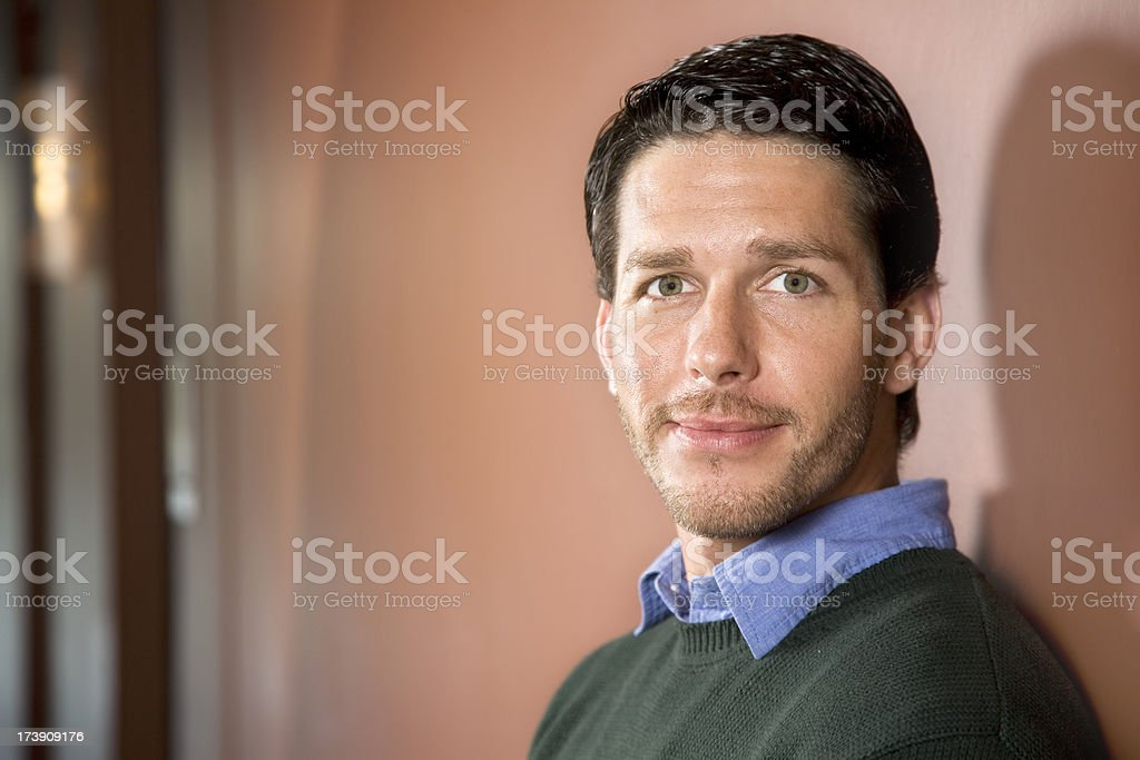 Attractive Man Standing In A Hall Way royalty-free stock photo