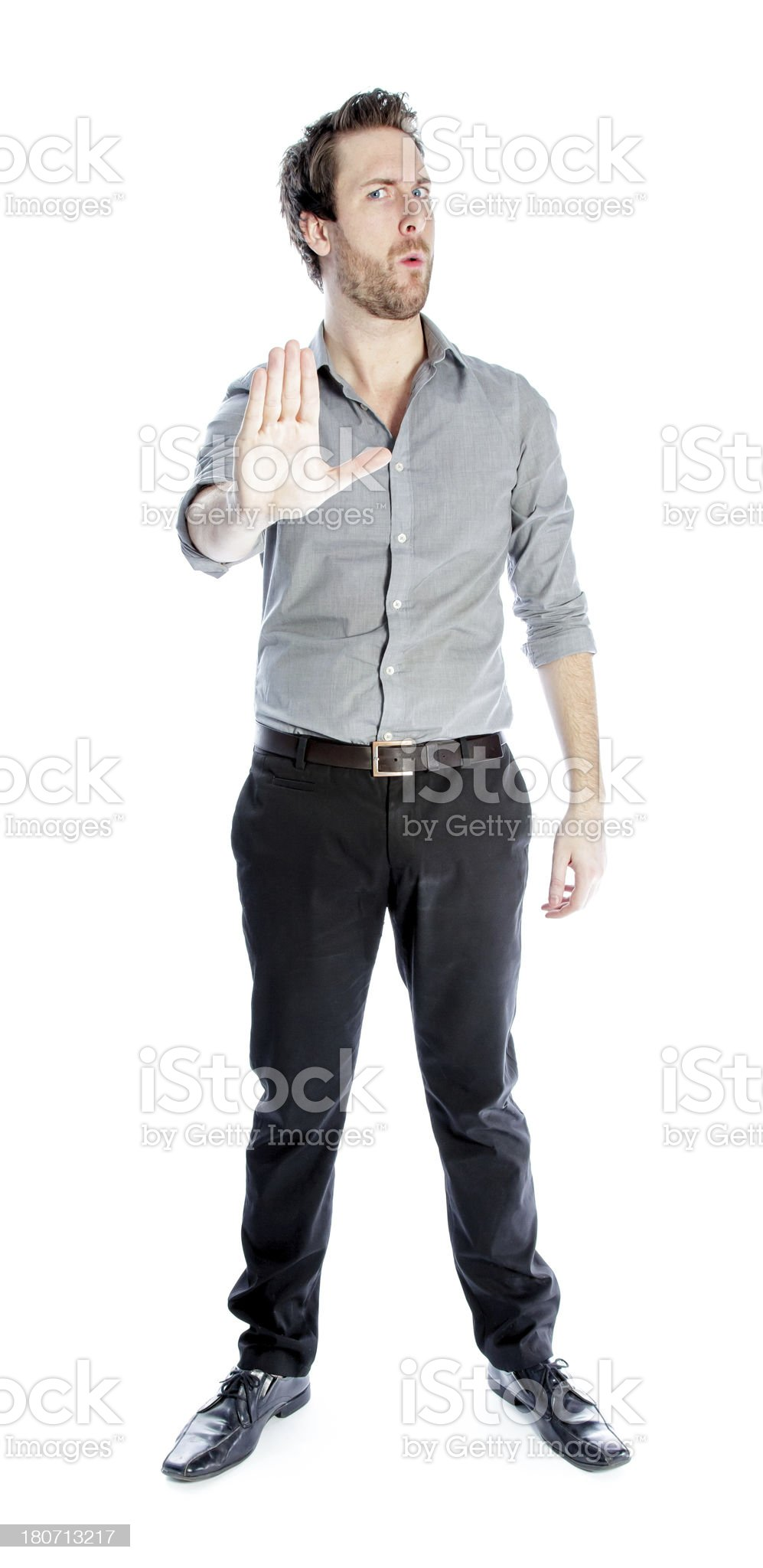 Attractive man wearing a grey shirt isolated on white background royalty-free stock photo