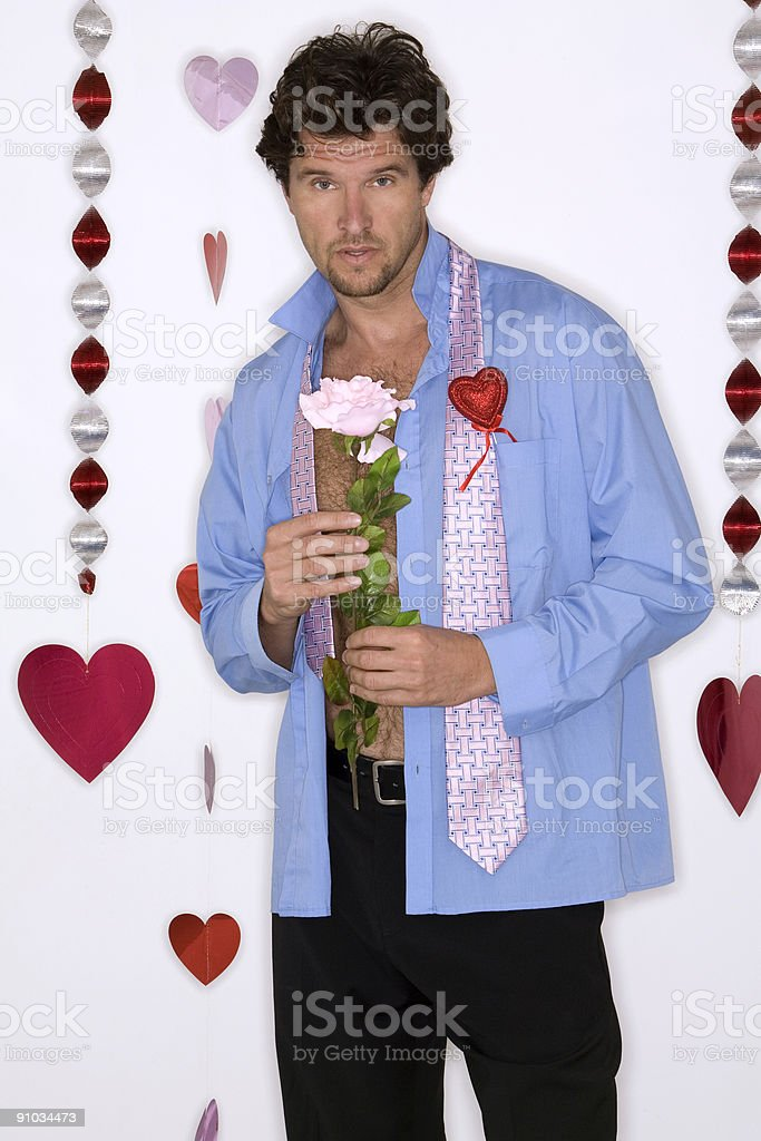 attractive man wearing blue shirt for valentines day royalty-free stock photo