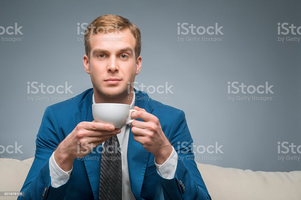 Attractive man with cup of tea stock photo