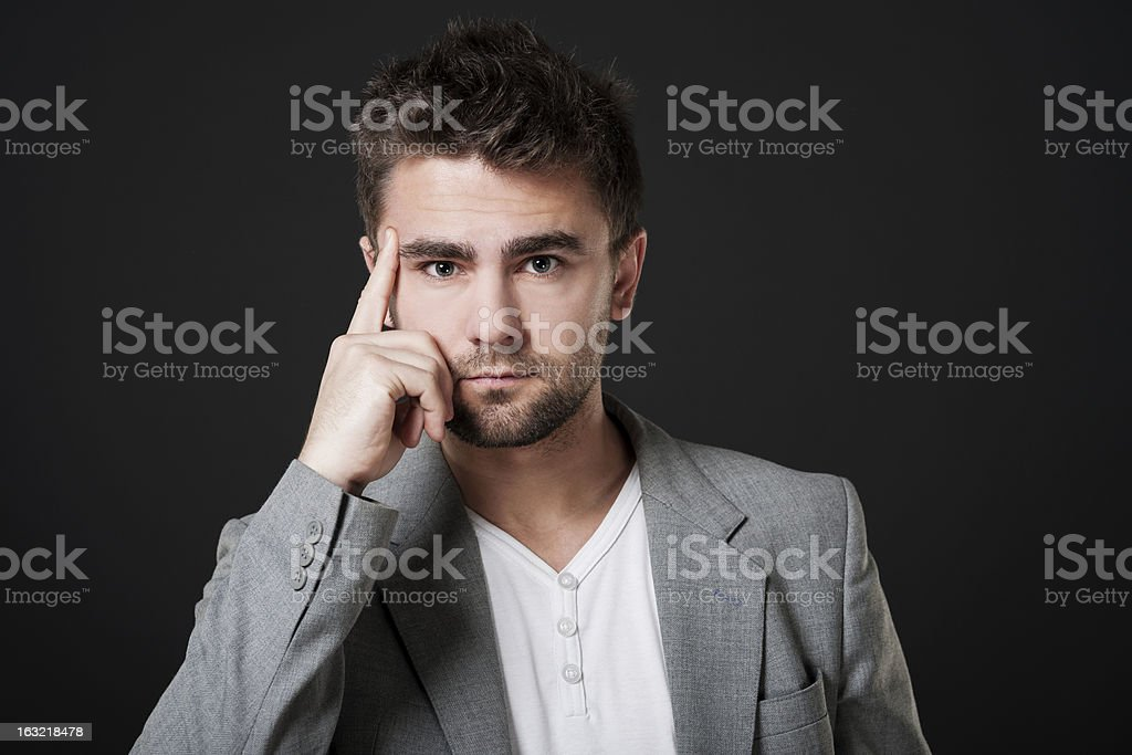 Attractive man with hand on chin royalty-free stock photo