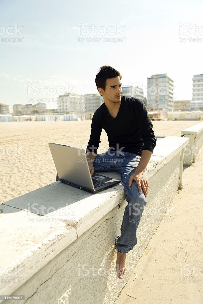 Attractive man with laptop outdoor royalty-free stock photo