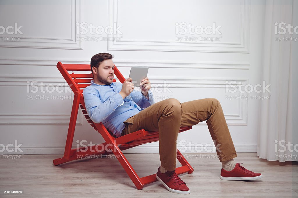Attractive man working on tablet pc stock photo