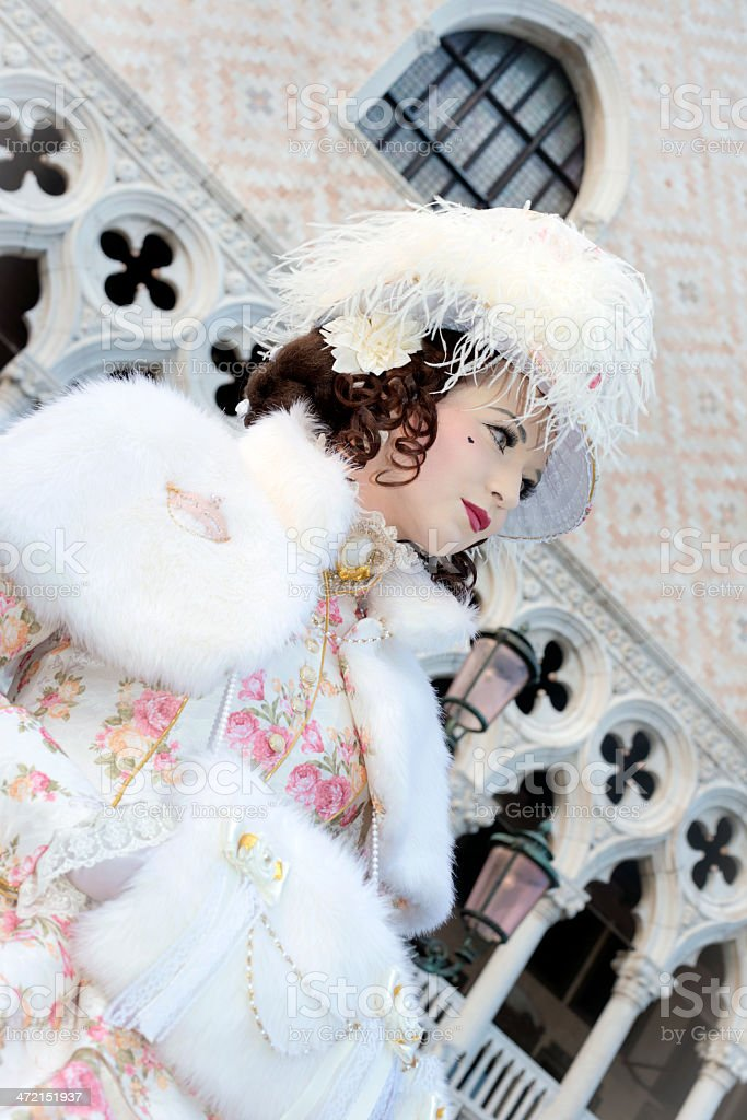 Attractive Mask by Doges Palace, Venice Carnival, Italy, Europe royalty-free stock photo
