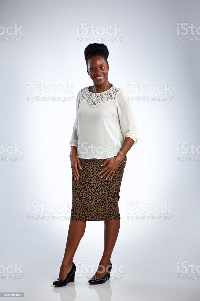 Attractive mature african woman posing in beautiful dress stock photo