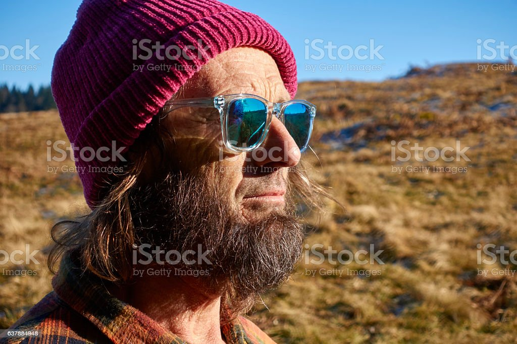 Attractive Mature Man Hiking in the Swiss Alps in Sunshine stock photo