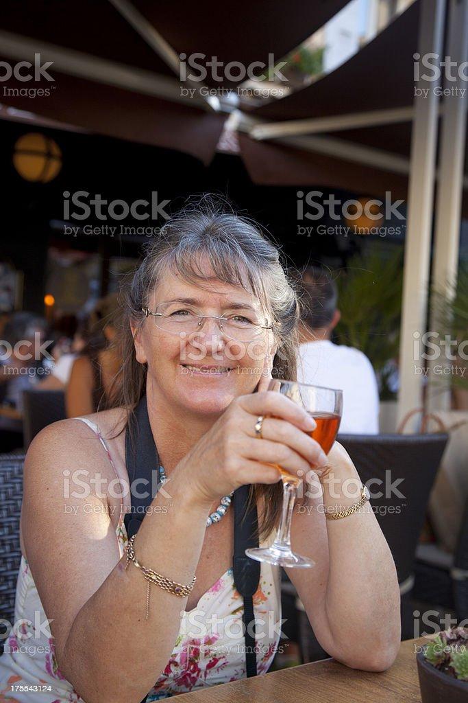 attractive mature woman enjoying drink stock photo