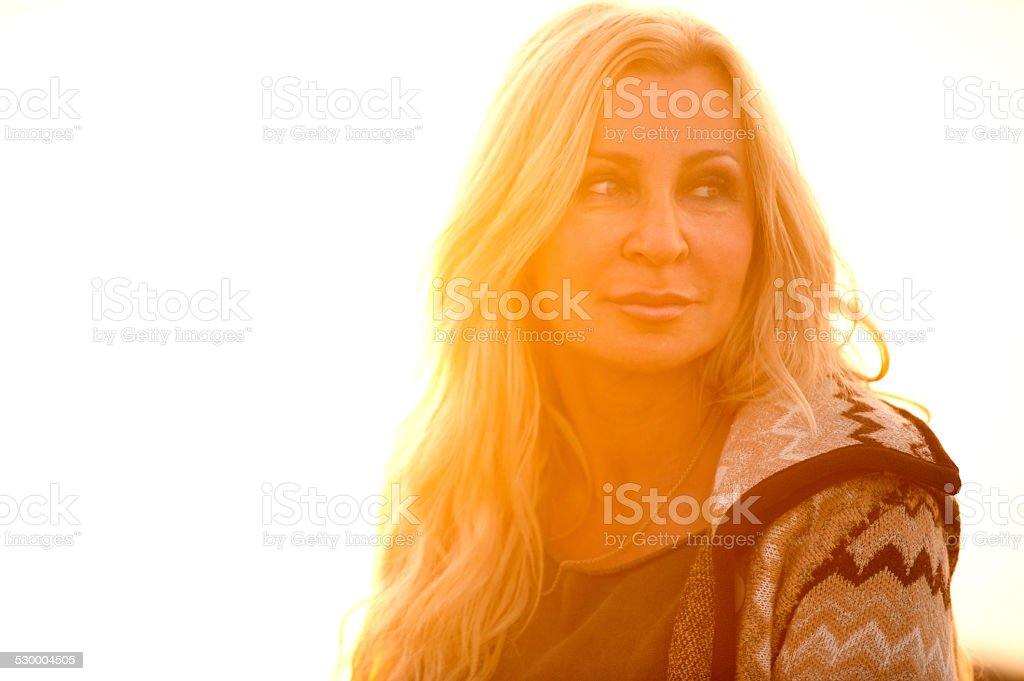 Attractive Mature Woman In Woolen Clothings stock photo