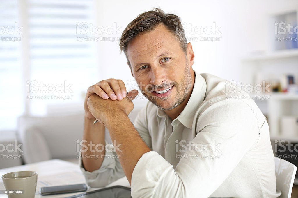Attractive middle-aged man at home royalty-free stock photo