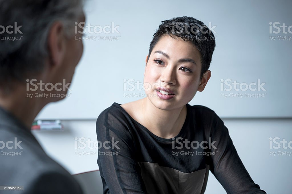Attractive mixed race businesswoman with short black hair, portrait stock photo