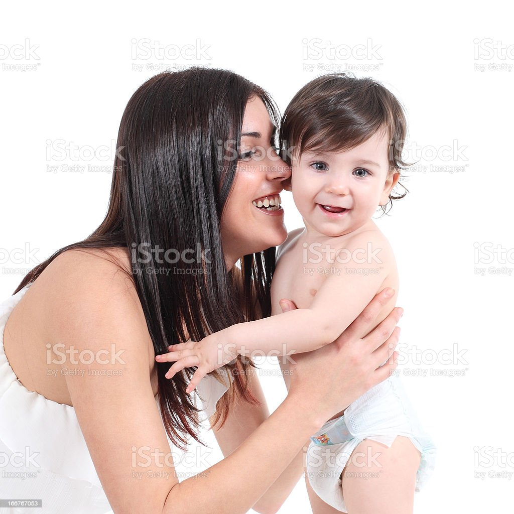 Attractive mother embracing her baby royalty-free stock photo