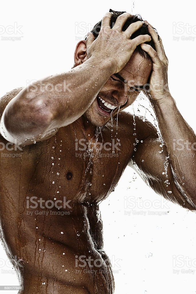Attractive muscular man in shower royalty-free stock photo