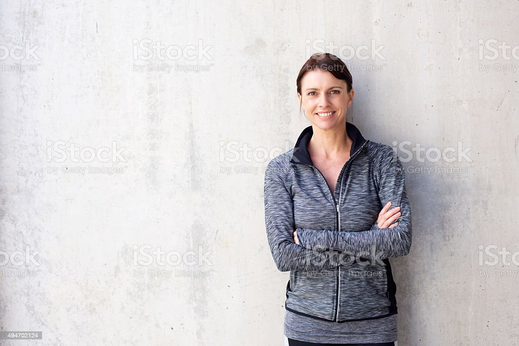Attractive older sports woman smiling stock photo