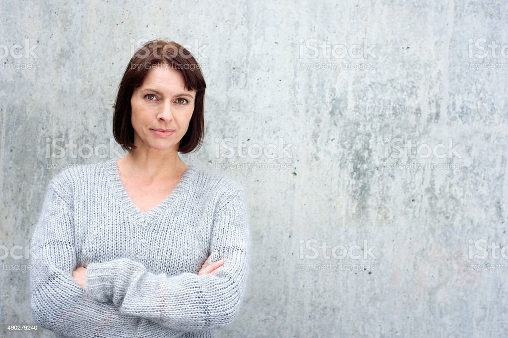 Attractive older woman in wool sweater stock photo
