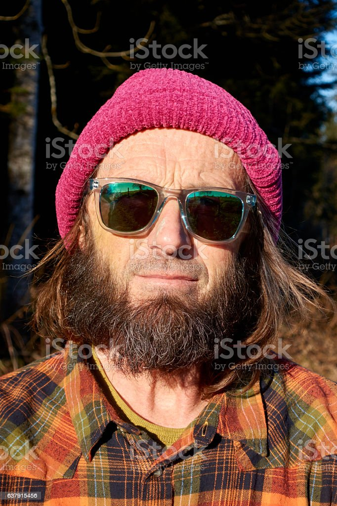 Attractive Outdoorsman Looking into Camera stock photo