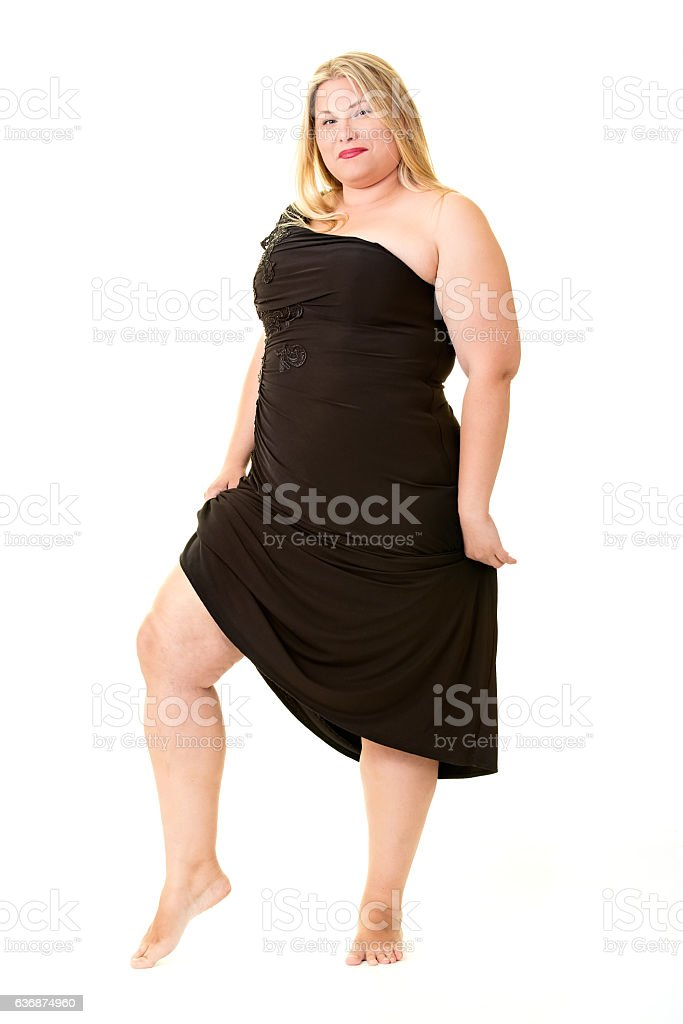 Attractive overweight woman in black evening dress. stock photo