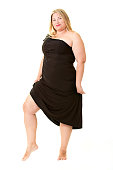 Attractive overweight woman in black evening dress.
