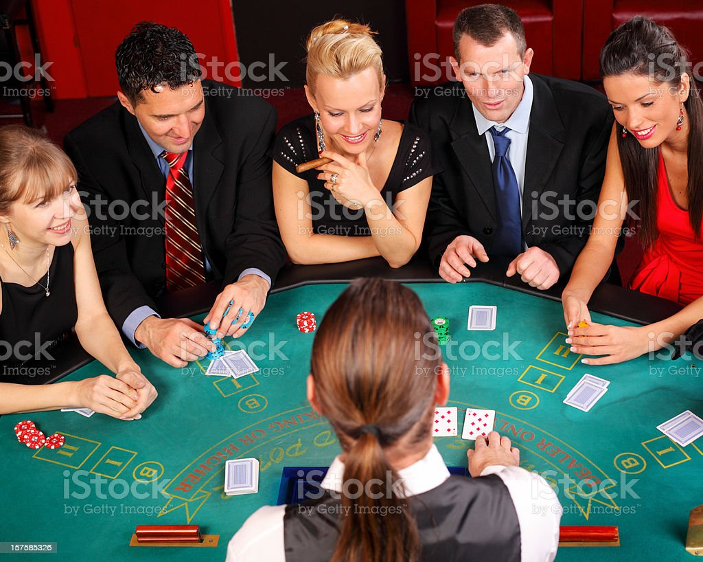 Attractive people having fun at the Blackjacks table. royalty-free stock photo