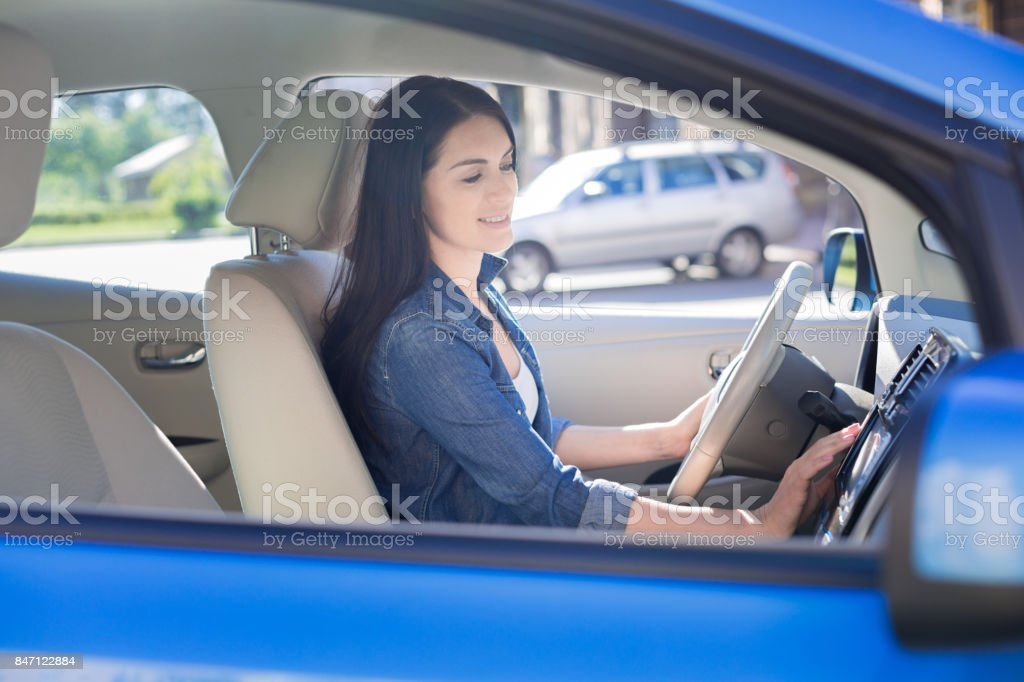 Attractive pretty woman staring her car stock photo