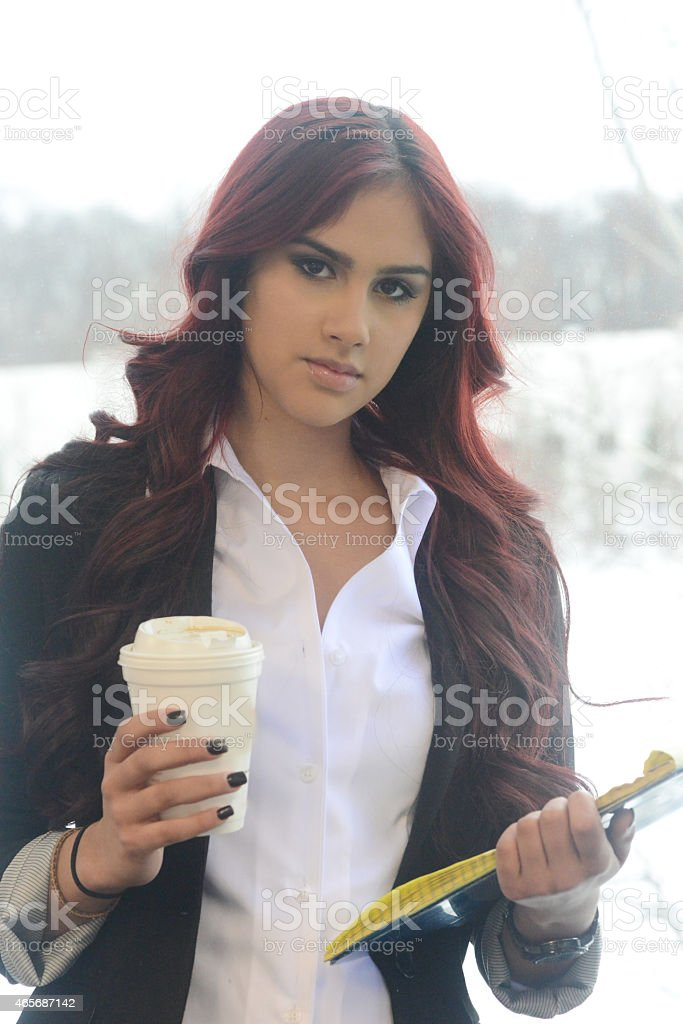 Attractive red headed woman at the office stock photo