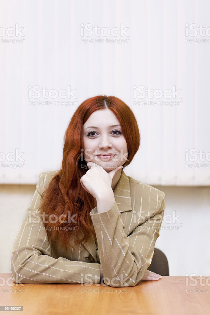 Attractive redhead woman in classic suit stock photo