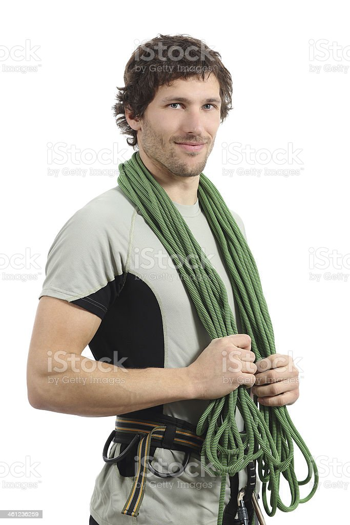 Attractive rock climber posing with harness and cord stock photo
