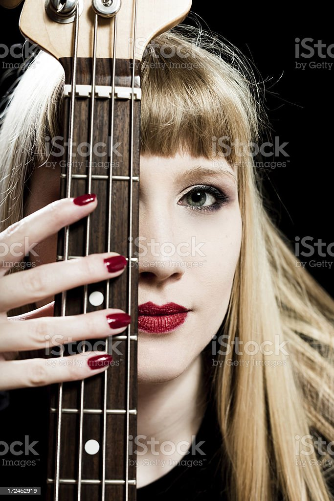 Attractive rock girl with bass guitar royalty-free stock photo