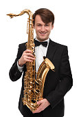 Attractive saxophonist with a saxophone in suit.