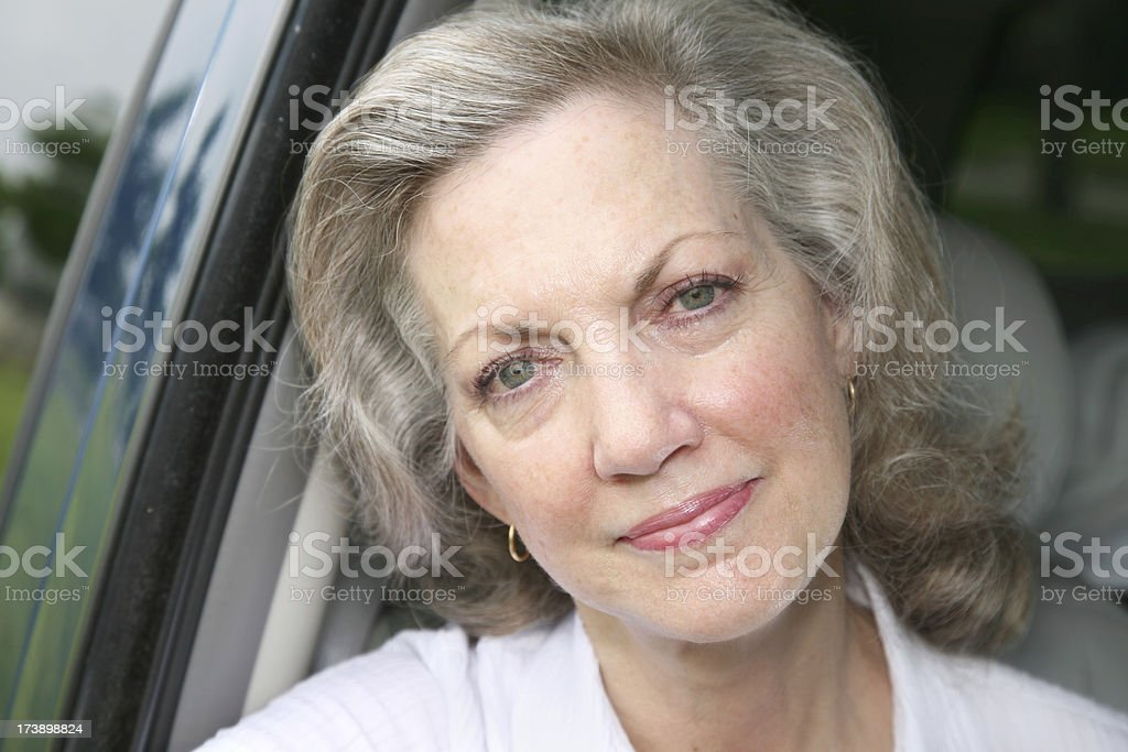 Attractive Senior Adult Woman in Her Car royalty-free stock photo