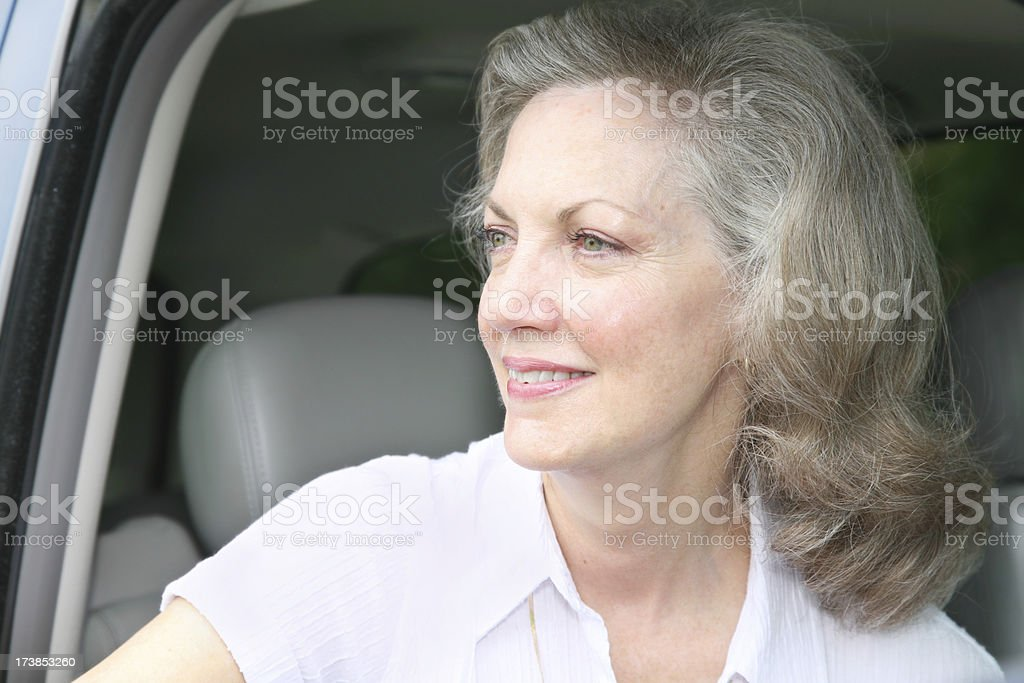 Attractive Senior Adult Woman Looking Out of Her Car royalty-free stock photo