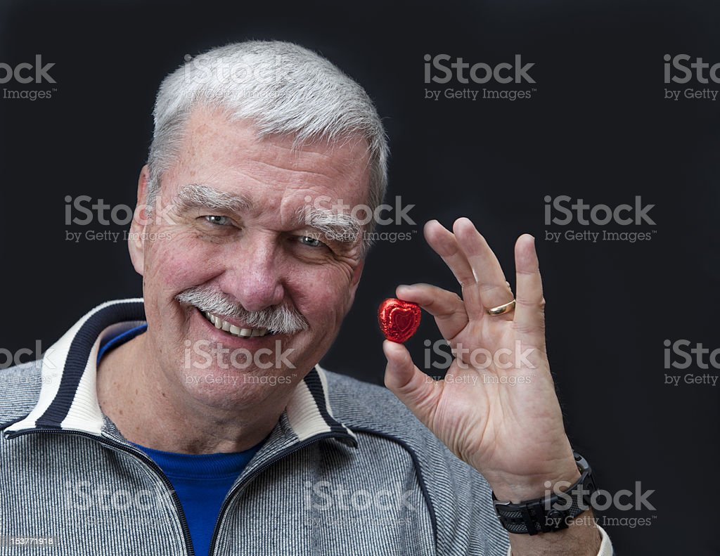 Attractive Senior Male With Candy Heart royalty-free stock photo