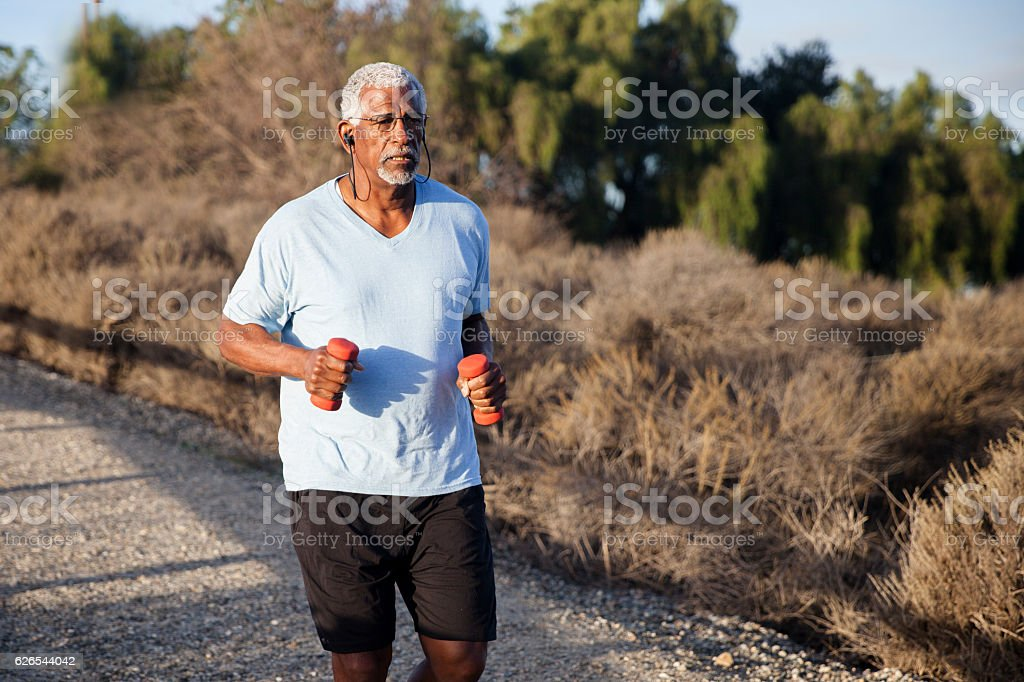 Attractive Senior Man Jogging stock photo