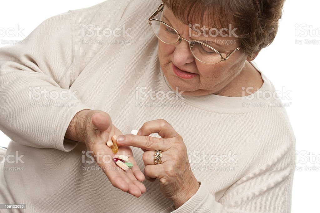 Attractive Senior Woman and Medication Pills royalty-free stock photo