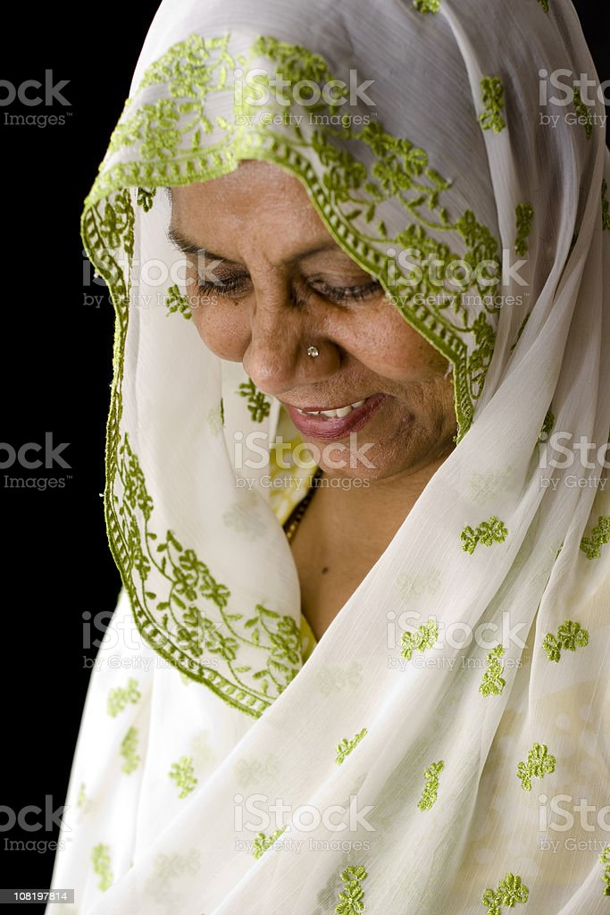 Attractive Senior Woman of Asian and Indian Ethnicities royalty-free stock photo