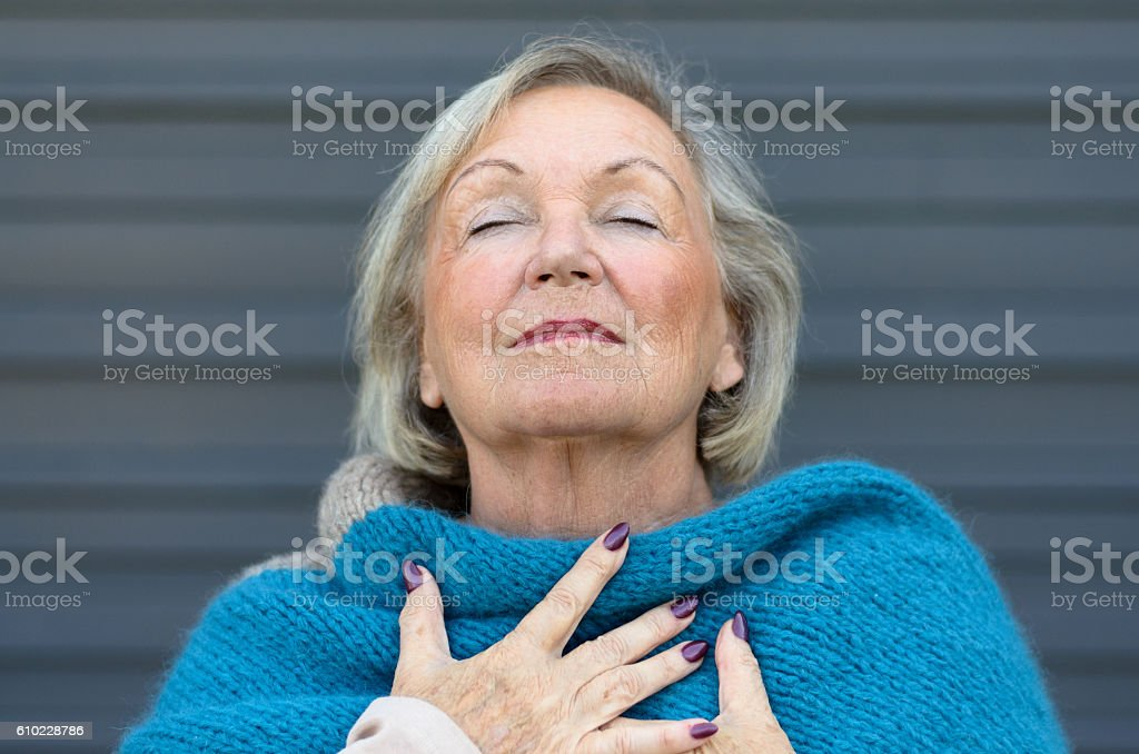 Attractive senior woman savoring the moment stock photo