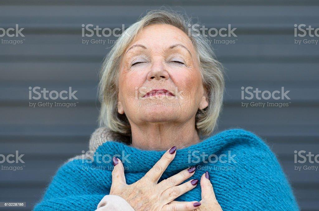 Attractive senior woman savoring the moment stock photo