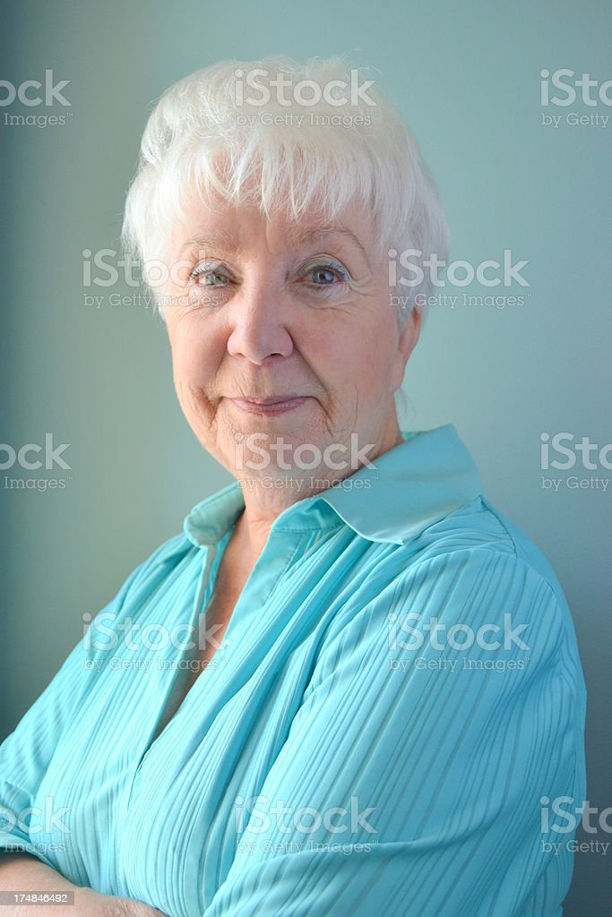 Attractive Senior Woman, smiling, looking bemused royalty-free stock photo