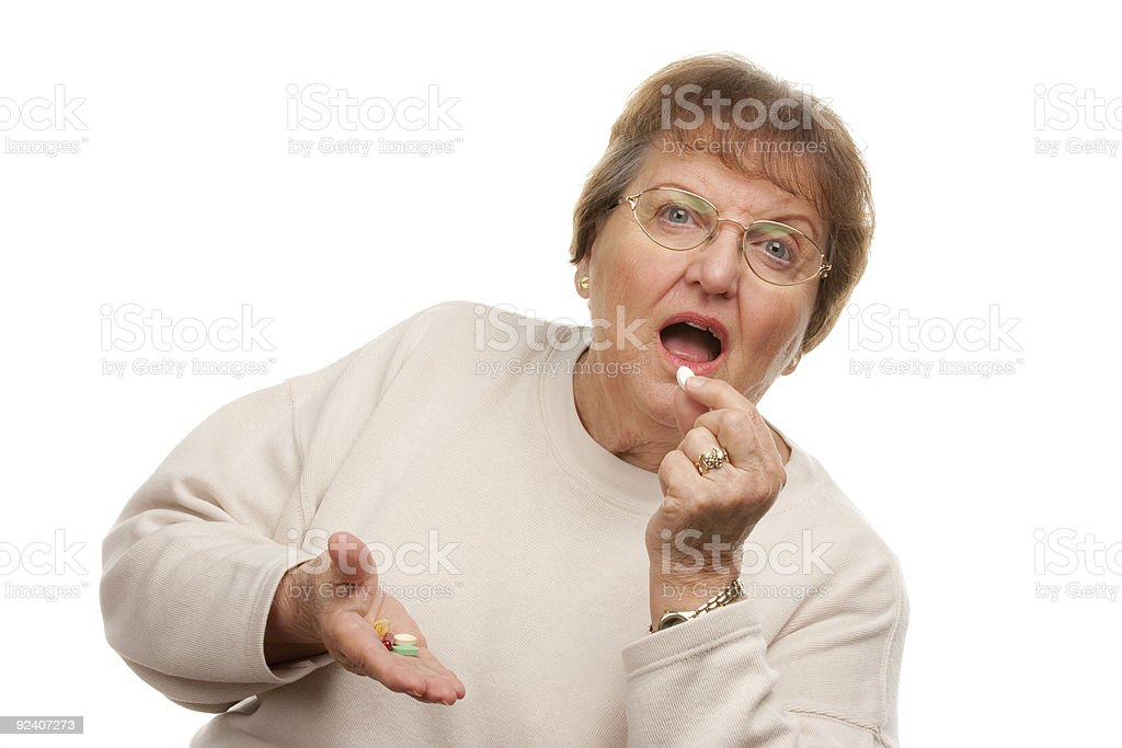 Attractive Senior Woman Taking Pills royalty-free stock photo